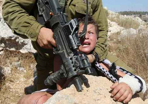 2048x1536-fit_an-israeli-soldier-controls-a-palestinian-boy-during-clashes-between-israeli-security-forces-and